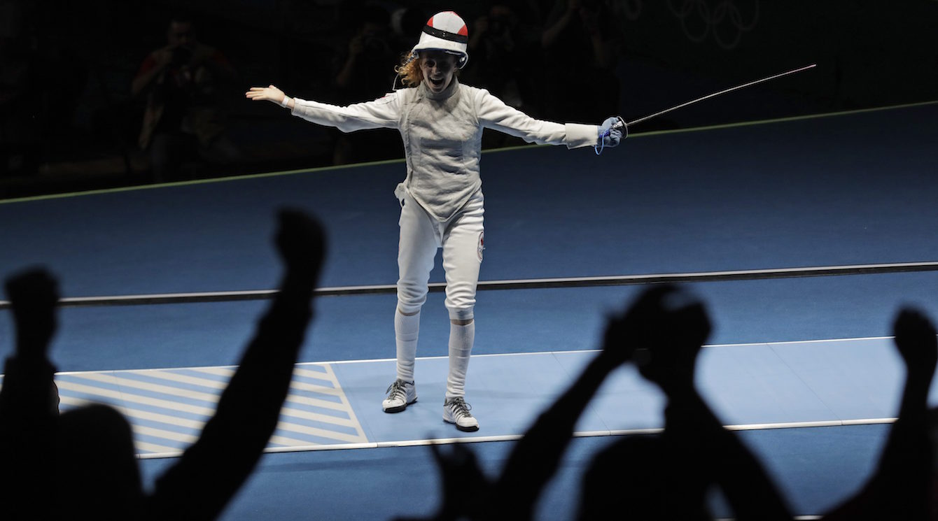 Eleanor Harvey of Canada celebrates after defeating Arianna Errigo of Italy in a women's individual foil event at the 2016 Summer Olympics in Rio de Janeiro, Brazil, Wednesday, Aug. 10, 2016. (AP Photo/Andrew Medichini)