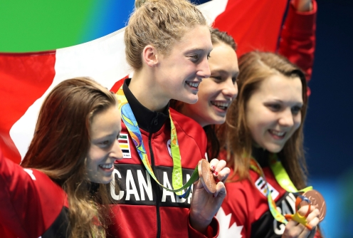 The Canada team hold up their bronze medals after winning the women's 4x200-meter freestyle relay during the swimming competitions at the 2016 Summer Olympics, Thursday, Aug. 11, 2016, in Rio de Janeiro, Brazil. (AP Photo/Lee Jin-man)