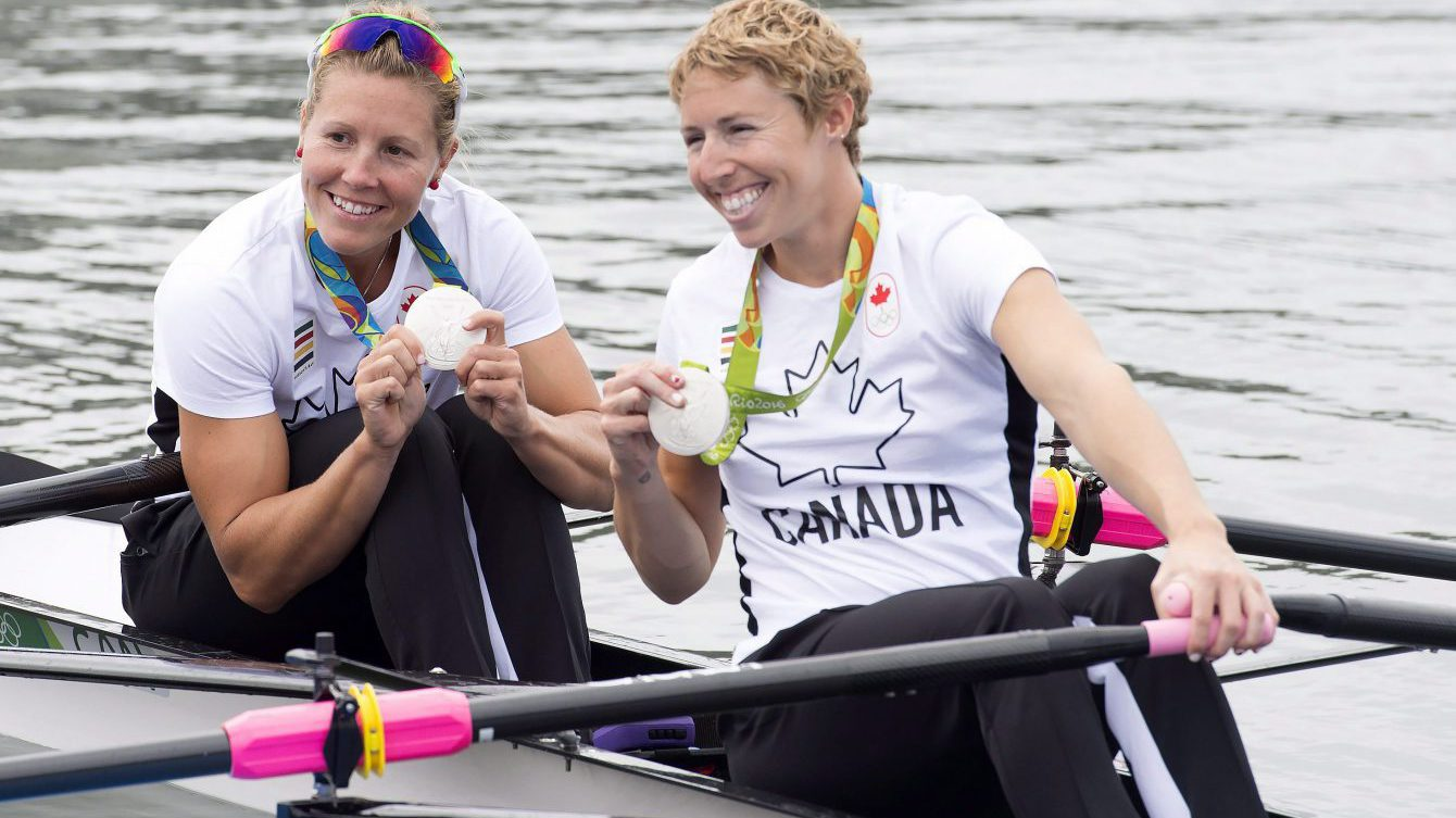 Canadian rowers Lindsay Jennerich and Patricia Obee, right, show off their silver medals in the women's lightweight double sculls at the 2016 Summer Olympics in Rio de Janeiro, Brazil, Friday, Aug. 12, 2016. THE CANADIAN PRESS/Frank Gunn