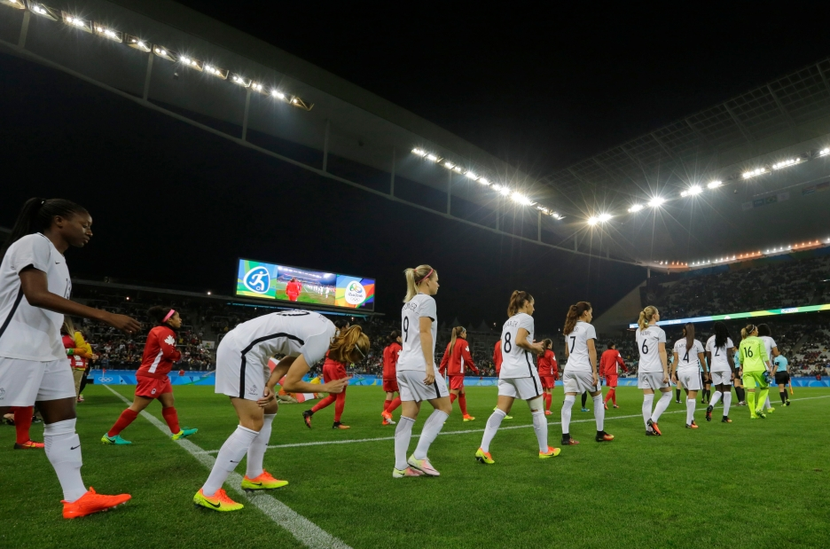 Players enter the pitch before a quarter-final match of the women's Olympic football tournament between Canada and France in Sao Paulo, Brazil, Friday Aug. 12, 2016.(AP Photo/Nelson Antoine)