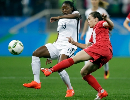 Canada's Allysha Chapman, right, and France's Kadidiatou Diani fight for the ball during a quarter-final match of the women's Olympic football tournament between Canada and France in Sao Paulo, Brazil, Friday Aug. 12, 2016.(AP Photo/Nelson Antoine)