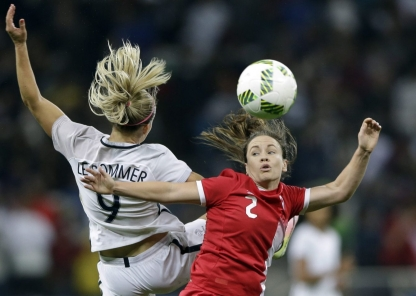 France's Eugenie Le Sommer, left, and Canada's Allysha Chapman go for a header during a quarter-final match of the women's Olympic football tournament between Canada and France in Sao Paulo, Brazil, Friday Aug. 12, 2016.(AP Photo/Nelson Antoine)