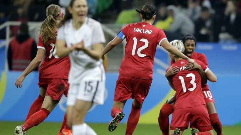 Canada's Sophie Schmidt, 13, celebrates with teammate Canada's Ashley Lawrence celebrates after scoring her team's first goal during a quarter-final match of the women's Olympic football tournament between Canada and France in Sao Paulo, Brazil, Friday Aug. 12, 2016.(AP Photo/Nelson Antoine)
