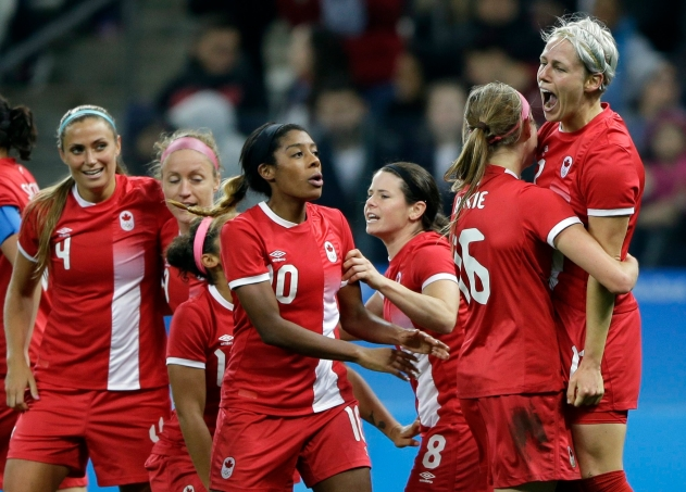 Canada's Sophie Schmidt, right, celebrates after scoring her team's first goal during a quarter-final match of the women's Olympic football tournament between Canada and France in Sao Paulo, Brazil, Friday Aug. 12, 2016.(AP Photo/Nelson Antoine)