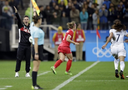 Canada coach John Herdman, left, shouts during a quarter-final match of the women's Olympic football tournament between Canada and France in Sao Paulo, Brazil, Friday Aug. 12, 2016. Canada's won1-0 and went through to the semi-finals.(AP Photo/Nelson Antoine)