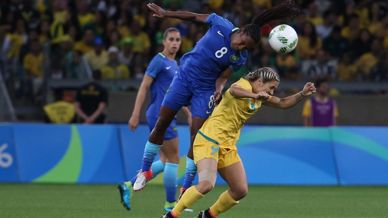 Brazil's Formiga, left, jumps for a header over Australia's Katrina Gorry during a quarter-final match of the women's Olympic football tournament between Brazil and Australia at the Mineirao Stadium in Belo Horizonte, Brazil, Friday Aug. 12, 2016. (AP Photo/Eugenio Savio)