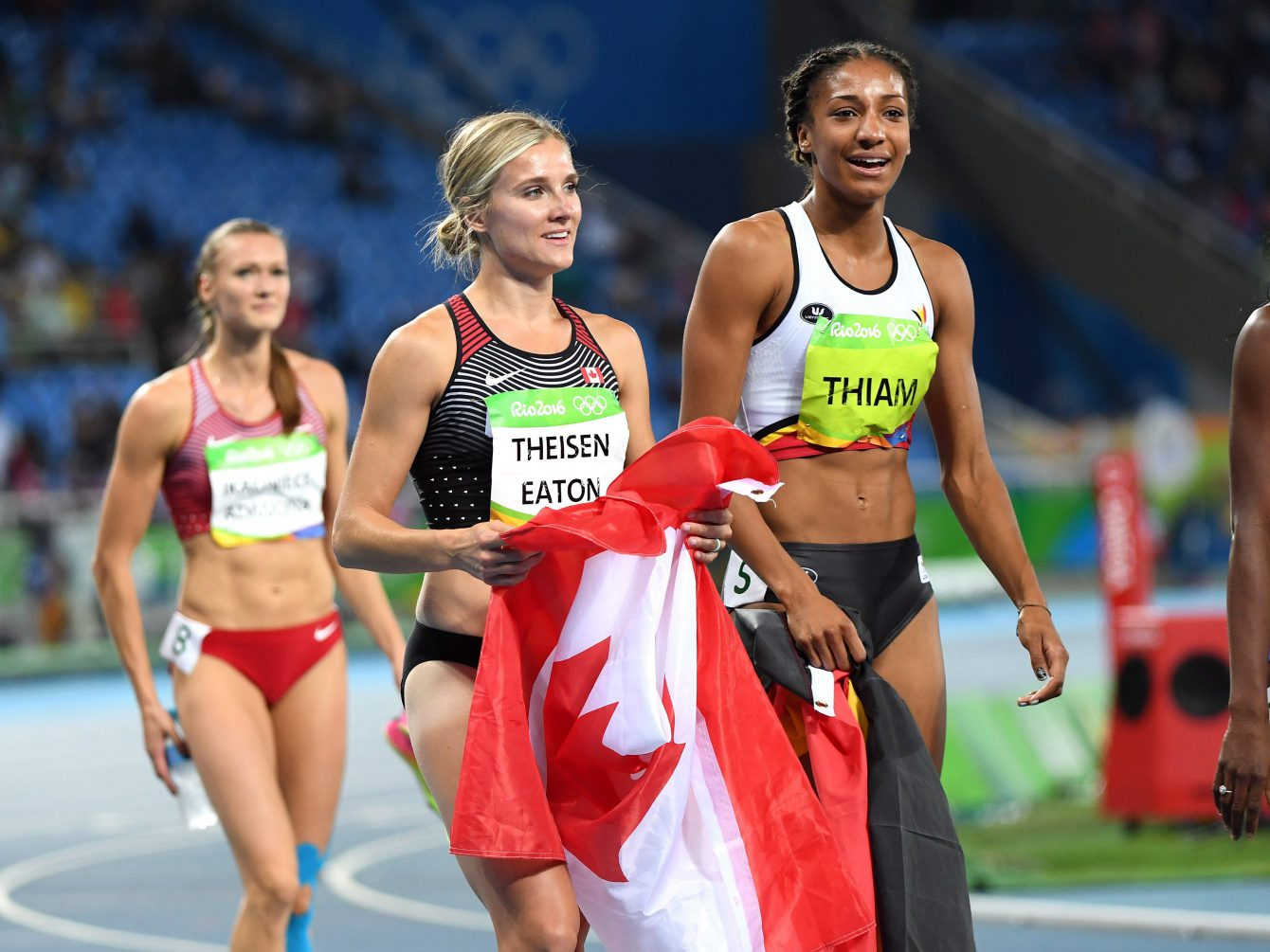 Canada's Brianne Theisen-Eaton, left, celebrates her bronze medal finish in front of gold medallist Nafissatou Thiam, of Belgium, in the women's heptathlon at the 2016 Olympic Games in Rio de Janeiro, Brazil on Saturday, Aug. 13, 2016. THE CANADIAN PRESS/Ryan Remiorz