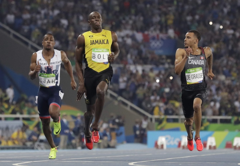 Jamaica's Usain Bolt, centre, Canada's Andre De Grasse, right, and Britain's Chijindu Ujah compete in a men's 100-meter semifinal during the athletics competitions of the 2016 Summer Olympics at the Olympic stadium in Rio de Janeiro, Brazil, Sunday, Aug. 14, 2016. (AP Photo/David J. Phillip)