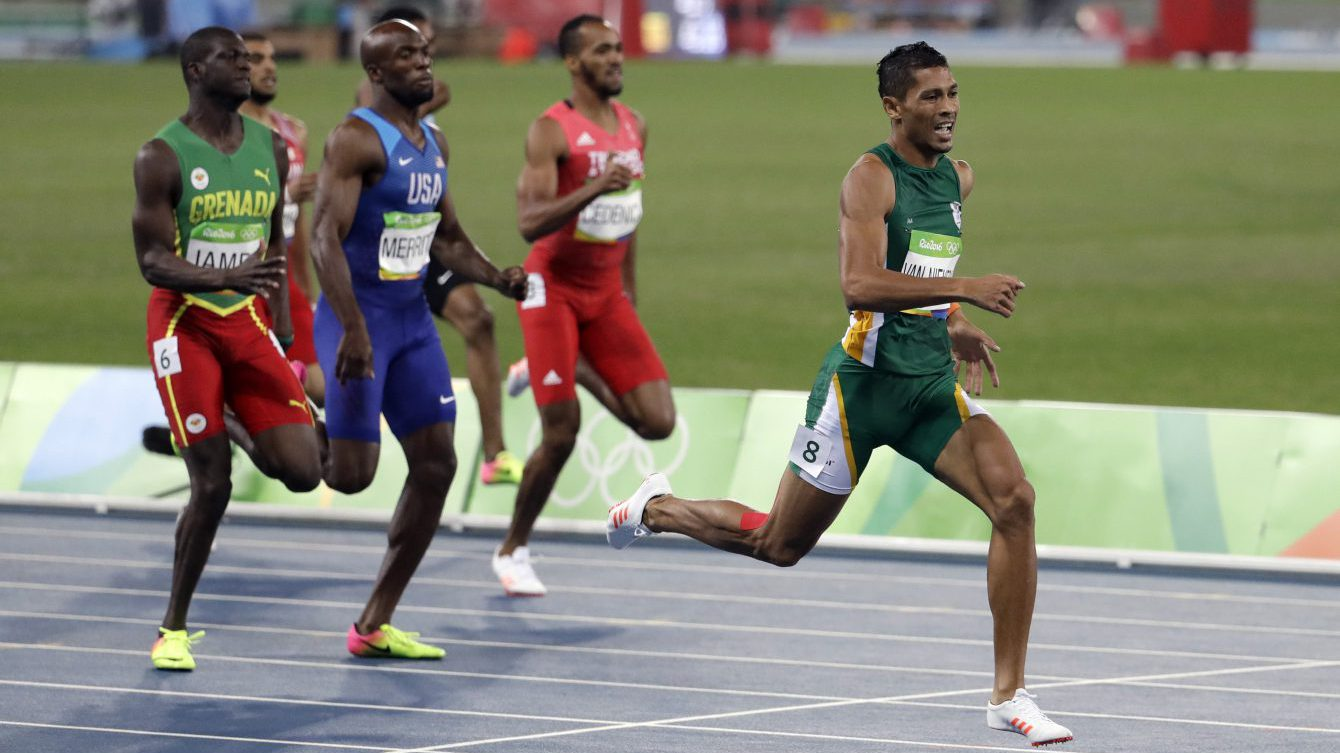 South Africa's Wayde Van Niekerk, right, competes in the men's 400-meter final during the athletics competitions of Rio 2016 at the Olympic stadium in Rio de Janeiro, Brazil, Sunday, Aug. 14, 2016. (AP Photo/Natacha Pisarenko)