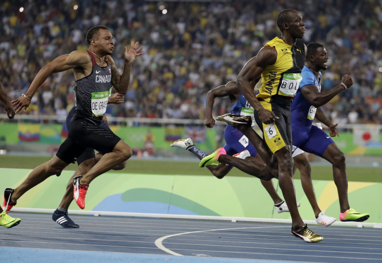 Jamaica's Usain Bolt sprints ahead of Canada's Andre de Grasse, left, and United States' Justin Gatlin in the men's 100-meter final during the athletics competitions of the 2016 Summer Olympics at the Olympic stadium in Rio de Janeiro, Brazil, Sunday, Aug. 14, 2016. (AP Photo/David Goldman)