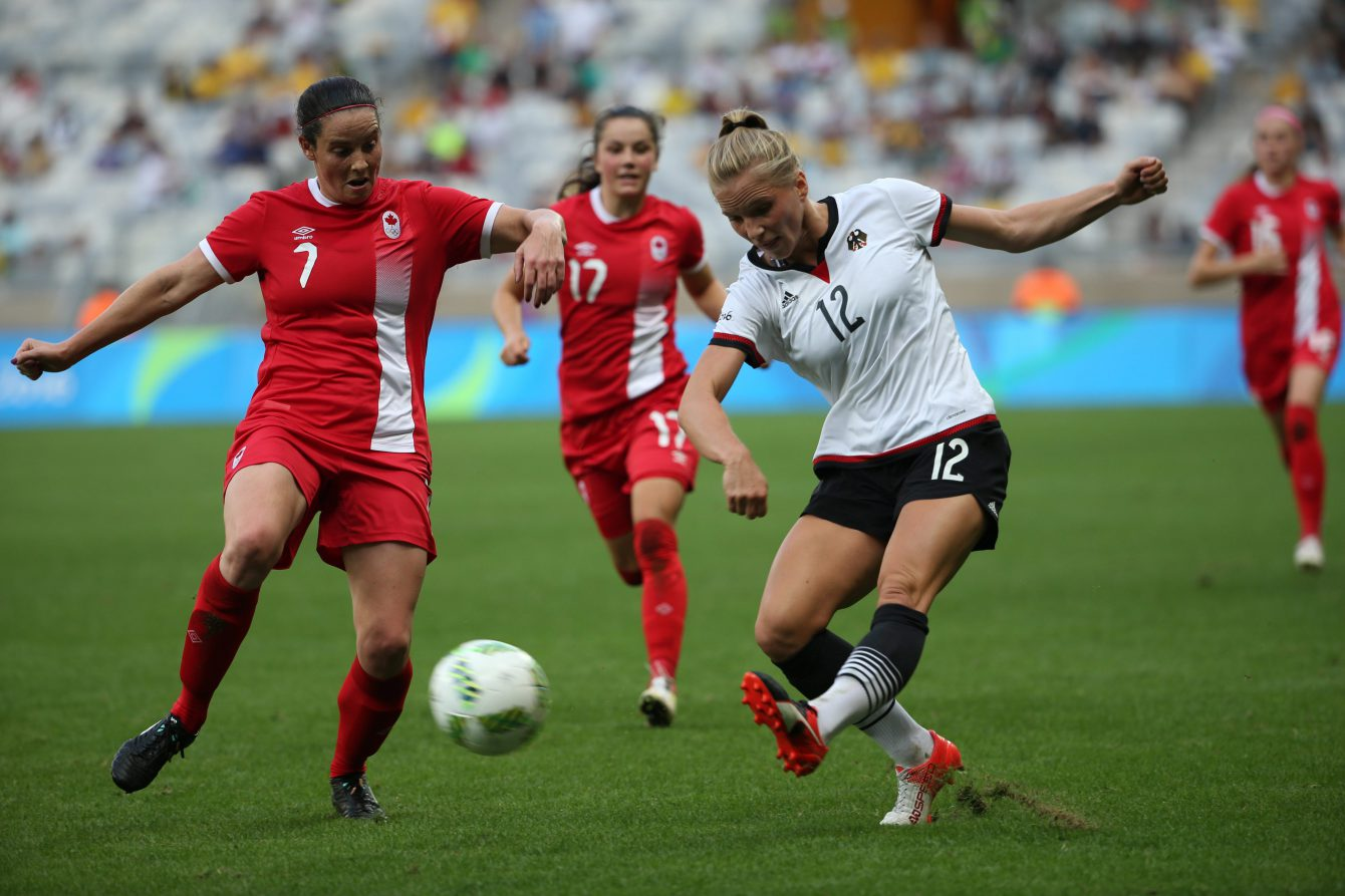 Germany's Tabea Kemme, right, kicks the ball past Canada's Rhian Wilkinson during a semi-final match of the women's Olympic football tournament between Canada and Germany at the Mineirao stadium in Belo Horizonte, Brazil, Tuesday Aug. 16, 2016. (AP Photo/Eugenio Savio)