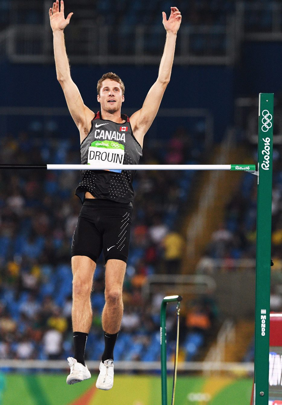Canada's Derek Drouin celebrates after clearing his fifth jump during the men's high jump final at the 2016 Summer Olympics in Rio de Janeiro, Brazil, Tuesday, August 16, 2016. THE CANADIAN PRESS/Sean Kilpatrick