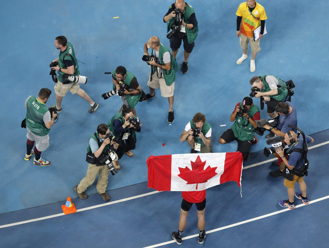 Canada's Derek Drouin poses for pictures after winning the gold medal in the high jump finals during the athletics competitions of the 2016 Summer Olympics at the Olympic stadium in Rio de Janeiro, Brazil, Tuesday, Aug. 16, 2016. (AP Photo/Morry Gash)
