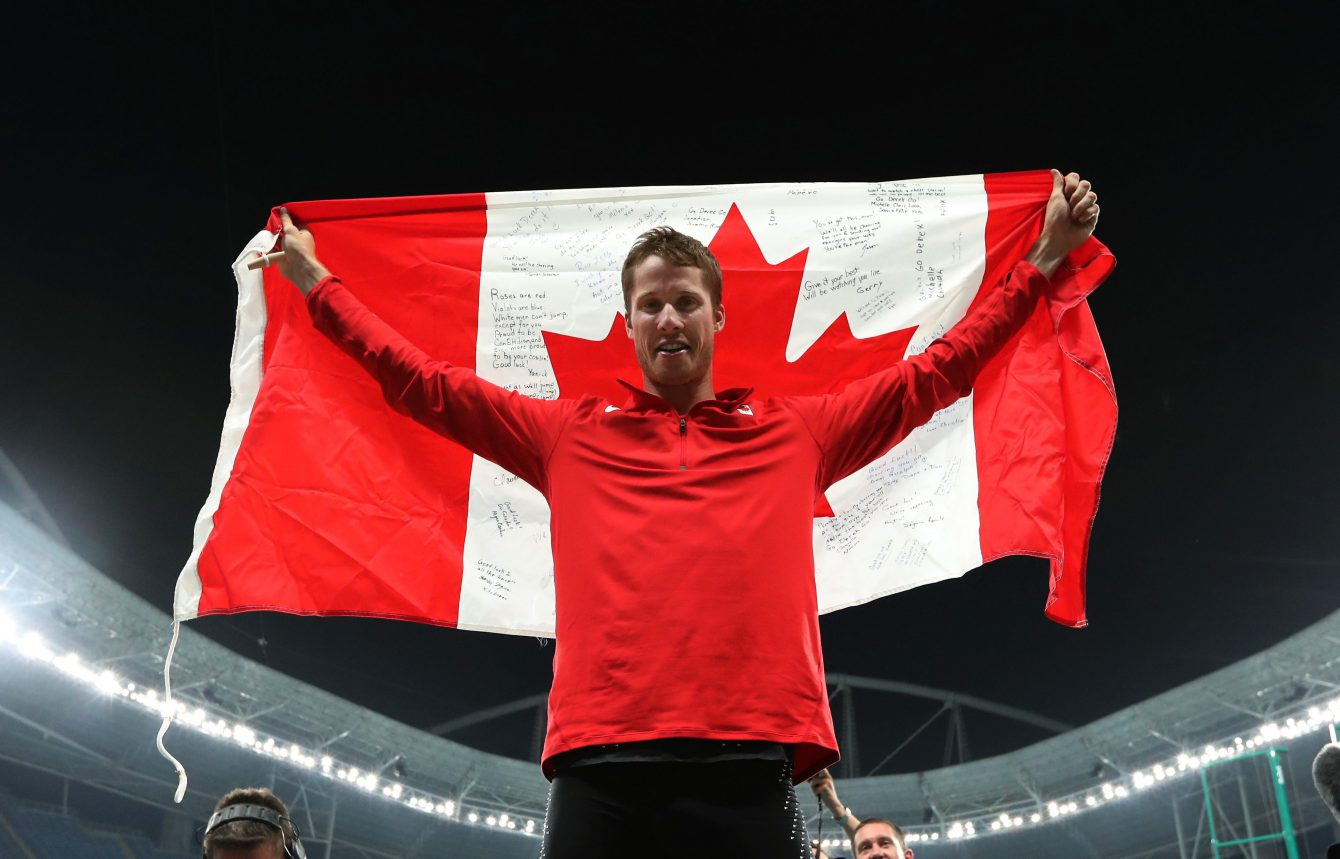 Canada's Derek Drouin celebrates after winning the gold medal in the men's high jump during the athletics competitions of the 2016 Summer Olympics at the Olympic stadium in Rio de Janeiro, Brazil, Tuesday, Aug. 16, 2016. (AP Photo/Lee Jin-man)