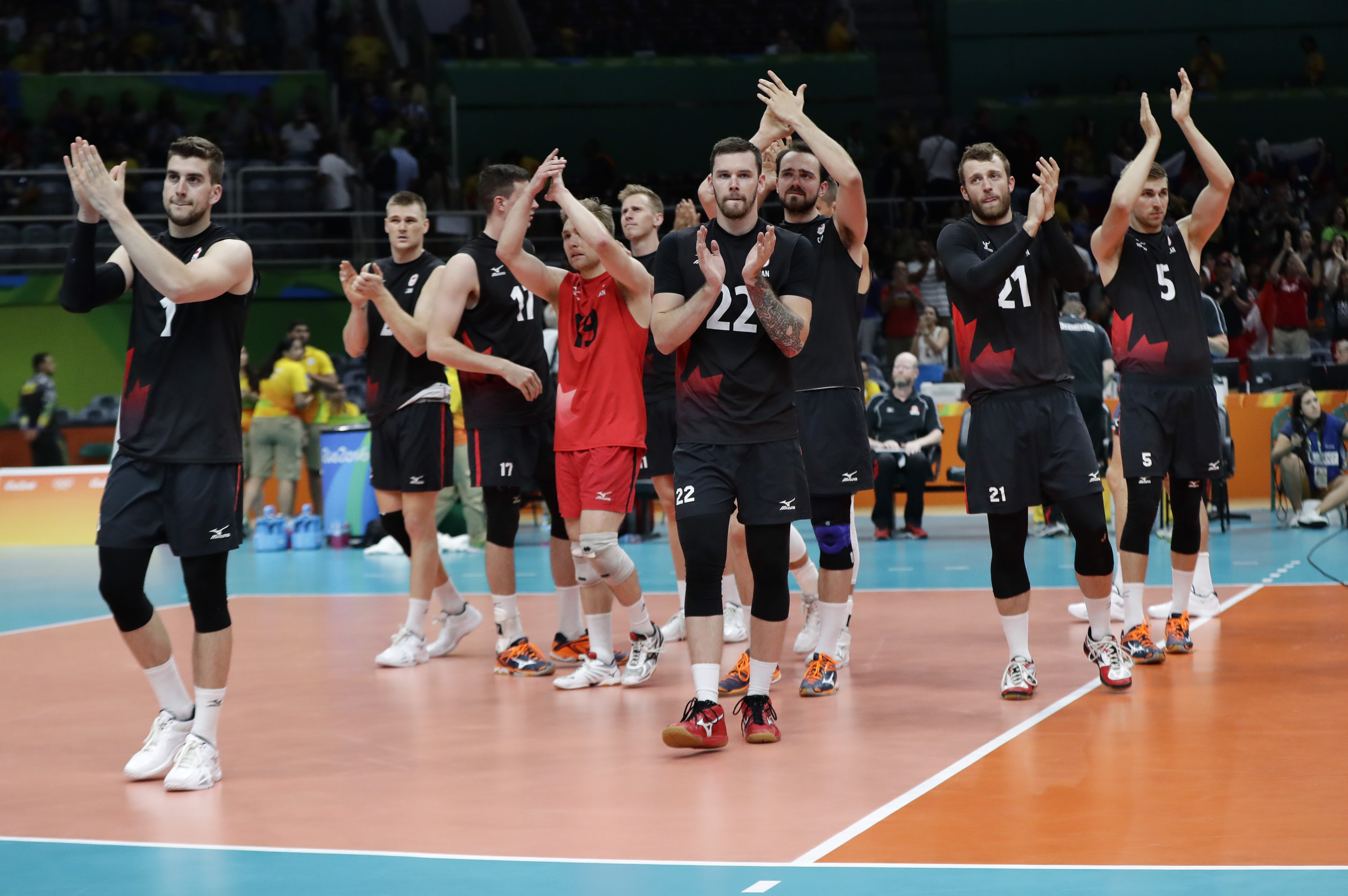 Canada's players applaud their fans after losing to Russia in straight sets in a men's quarterfinal volleyball match at the 2016 Summer Olympics in Rio de Janeiro, Brazil, Wednesday, Aug. 17, 2016. (AP Photo/Robert F. Bukaty)