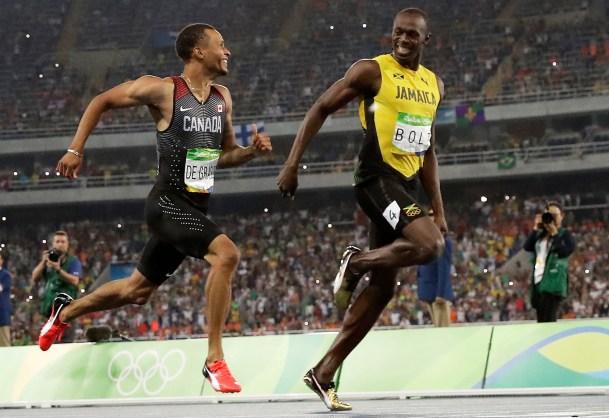 De Grasse and Bolt sprinting