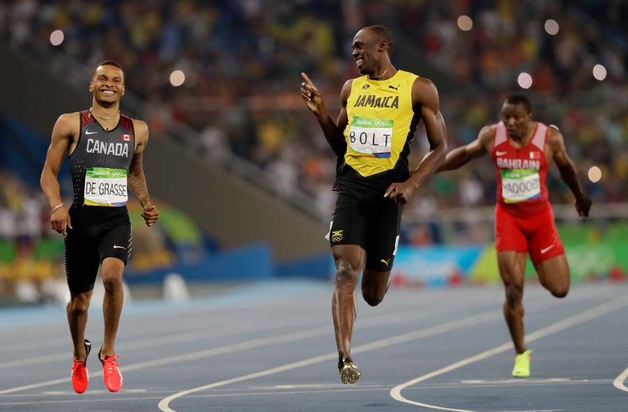 Usain Bolt, centre, competes in men's 200-meter semifinal at the 2016 Summer Olympics in Rio. (AP Photo/David J. Phillip)