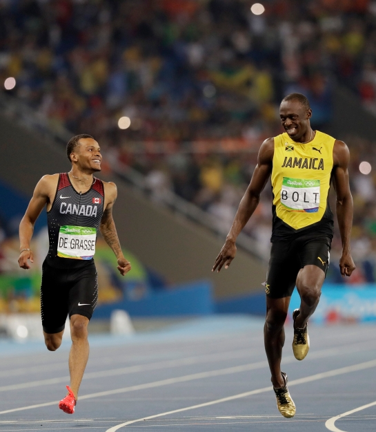 Jamaica's Usain Bolt, right, and Canada's Andre De Grasse compete in a men's 200-meter semifinal during the athletics competitions of the 2016 Summer Olympics at the Olympic stadium in Rio de Janeiro, Brazil, Wednesday, Aug. 17, 2016. (AP Photo/David J. Phillip)