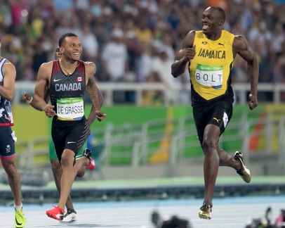 Canada's Andre De Grasse (left) and Jamaica's Usain Bolt share a laugh before they pass the finish line as they set the two fastest times in the 200-metre semifinals at the Olympic games in Rio de Janeiro, Brazil, Wednesday August 17, 2016. THE CANADIAN PRESS/Frank Gunn