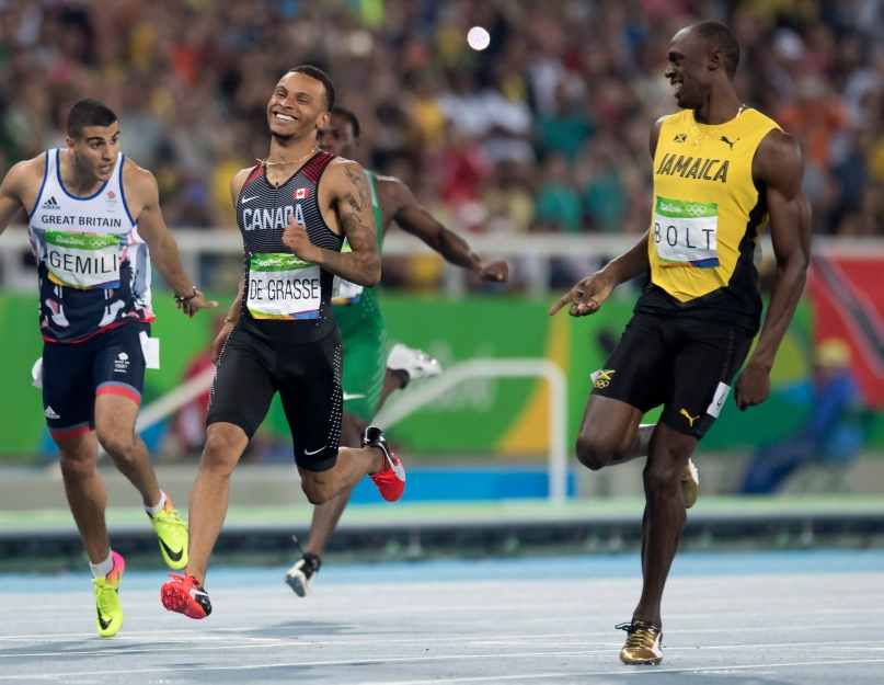 Canada's Andre De Grasse (left) and Jamaica's Usain Bolt share a laugh at the finish line as they set the two fastest times in the 200-metre semifinals at the Olympic games in Rio de Janeiro, Brazil, Wednesday August 17, 2016. THE CANADIAN PRESS/Frank Gunn