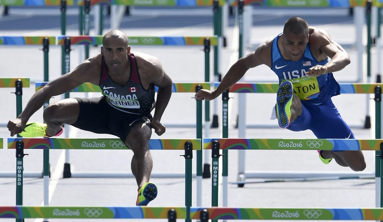 Canada's Damian Warner and United States' Ashton Eaton, right, compete in a men's decathlon 110-meter hurdles heat during the athletics competitions of the 2016 Summer Olympics at the Olympic stadium in Rio de Janeiro, Brazil, Thursday, Aug. 18, 2016. (AP Photo/Martin Meissner)