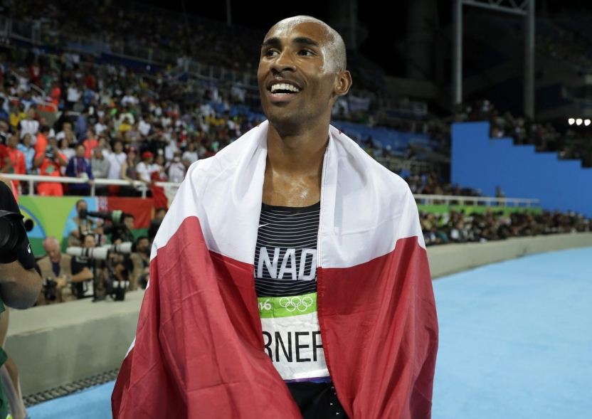 Canada's Damian Warner celebrates after winning the bronze medal in the decathlon, during the athletics competitions of the 2016 Summer Olympics at the Olympic stadium in Rio de Janeiro, Brazil, Thursday, Aug. 18, 2016. (AP Photo/Matt Slocum)