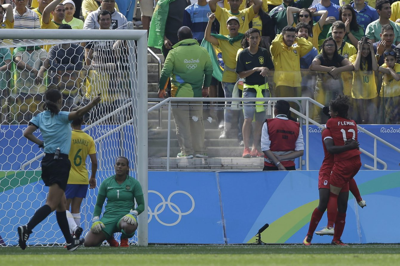 Canada's Deanne Rose, left, is congratulated after scoring her side's first goal by teammate Jessie Fleming during the bronze medal match of the women's Olympic football tournament between Brazil and Canada at the Arena Corinthians stadium in Sao Paulo, Friday Aug. 19, 2016. (AP Photo/Nelson Antoine)