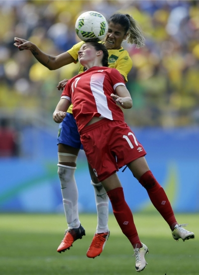 Canada's Jessie Fleming, front, heads the ball under pressure by Brazil's Fabiana during the bronze medal match of the women's Olympic football tournament between Brazil and Canada at the Arena Corinthians stadium in Sao Paulo, Friday Aug. 19, 2016. (AP Photo/Nelson Antoine)