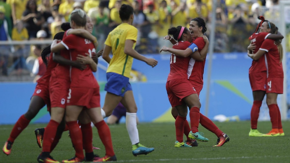 Canada players celebrate after beating Brazil 2-1 on the bronze medal match of the women's Olympic football tournament between Brazil and Canada at the Arena Corinthians stadium in Sao Paulo, Friday Aug. 19, 2016. (AP Photo/Nelson Antoine)