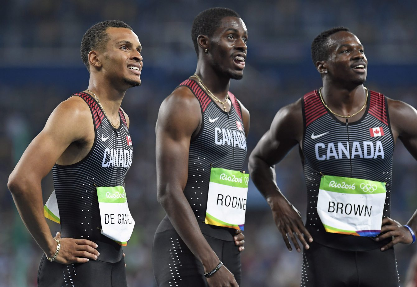 Canada's Andre De Grasse, left to right, Brendon Rodney and Aaron Brown watch the scoreboard following the men's 4x100-metre relay final at the 2016 Summer Olympics in Rio de Janeiro, Brazil on Friday, August 19, 2016. THE CANADIAN PRESS/Frank Gunn