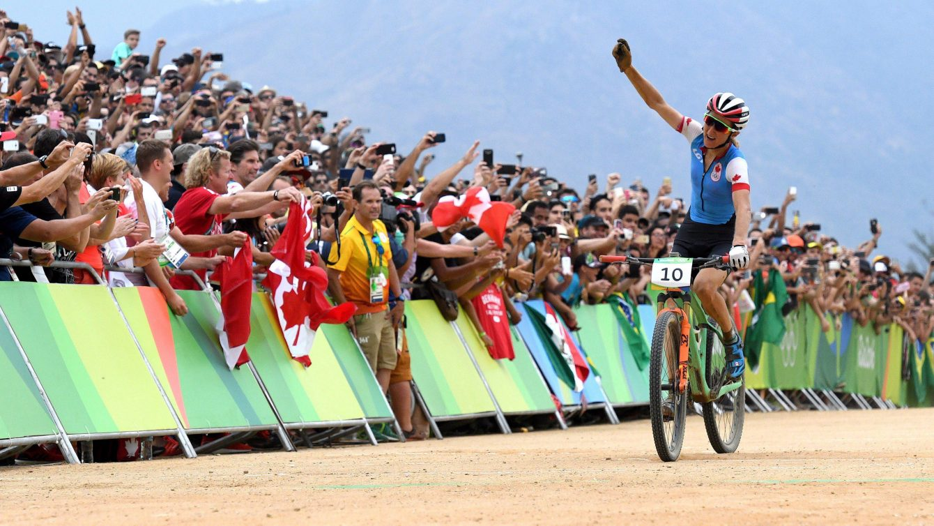 Canada's Catharine Pendrel celebrates bronze in the women's mountain bike final at the 2016 Olympic Summer Games in Rio de Janeiro, Brazil on Saturday, Aug. 20, 2016. THE CANADIAN PRESS/Sean Kilpatrick