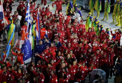 Athletes from Canada parade into the closing ceremony in the Maracana stadium at the 2016 Summer Olympics in Rio de Janeiro, Brazil, Sunday, Aug. 21, 2016. (AP Photo/Chris Carlson)