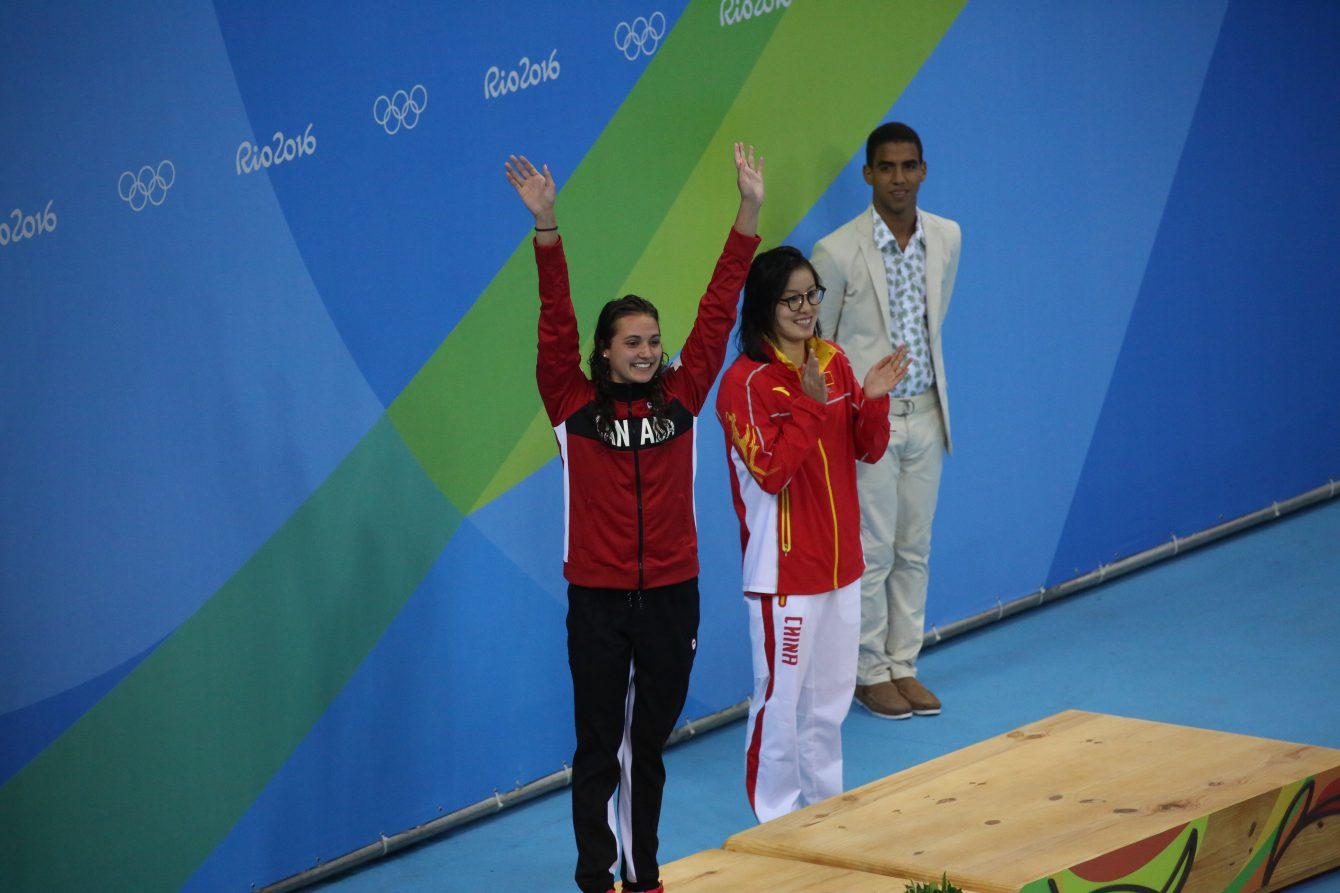 Canada's Kylie Masse being awarded her bronze medal after her 100m backstroke race on August 8, 2016