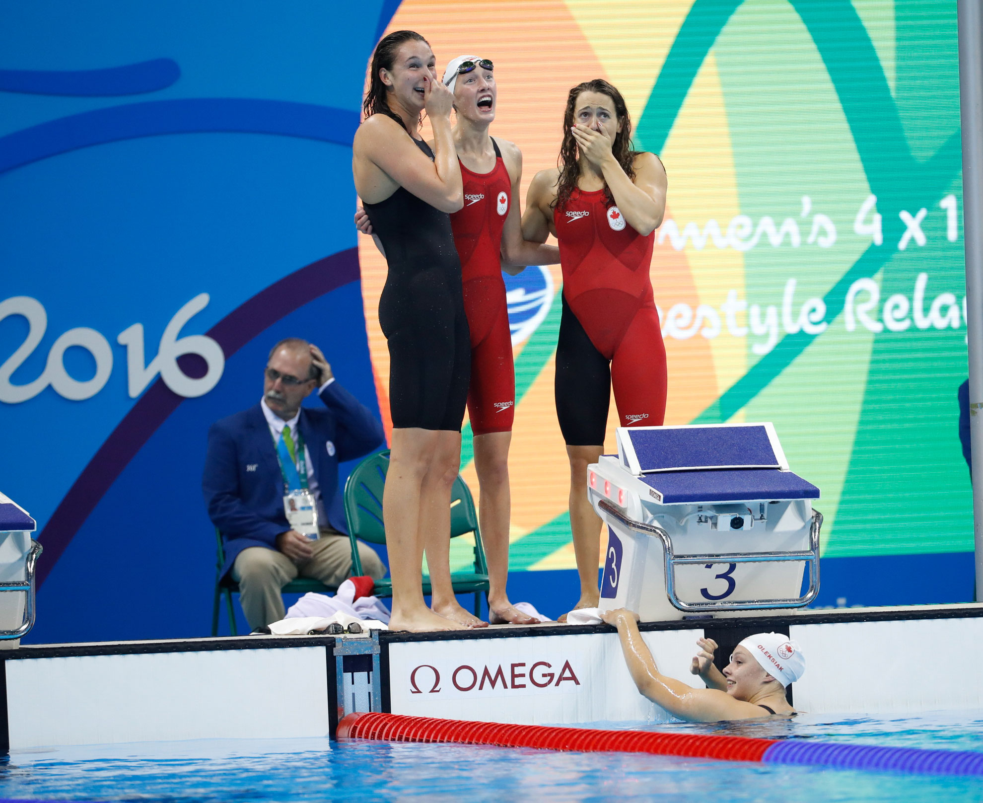 Rio 2016: 4x100m freestyle relay team realizes they've won an Olympic medal (Mark Blinch/COC).
