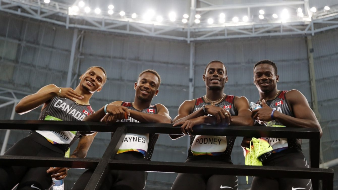 Canada's men's 4x100m relay team posing for a picture