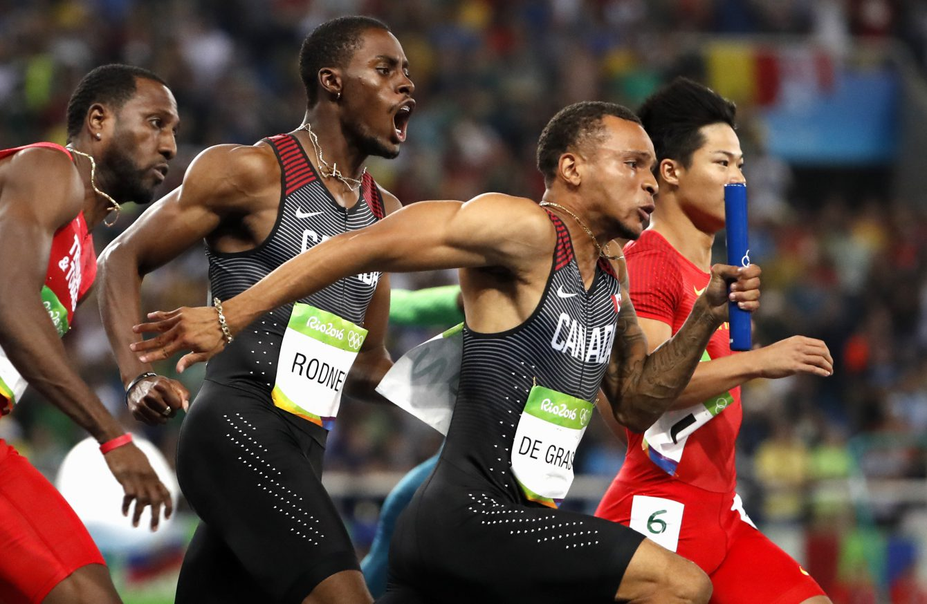 Andre De Grasse closes the final lag of the 4x100 relay