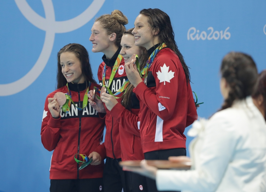 The Rio 2016 4x200m freestyle team wins bronze with Taylor Ruck, Penny Oleksiak, Brittany Maclean and Katerine Savard on August 10 2016. (Jason Ransom/COC)