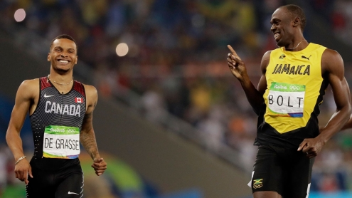 Andre De Grasse (left) and Usain Bolt share a laugh after crossing the finish line in the semifinals of the Olympic 200m on August 17, 2016 in Rio de Janeiro.
