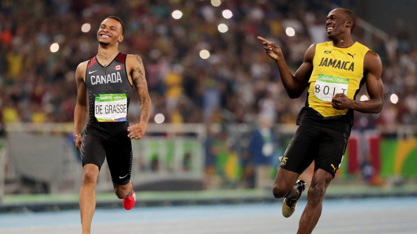 Andre De Grasse and Usain Boly share a laugh during the 200m semifinal at Rio 2016
