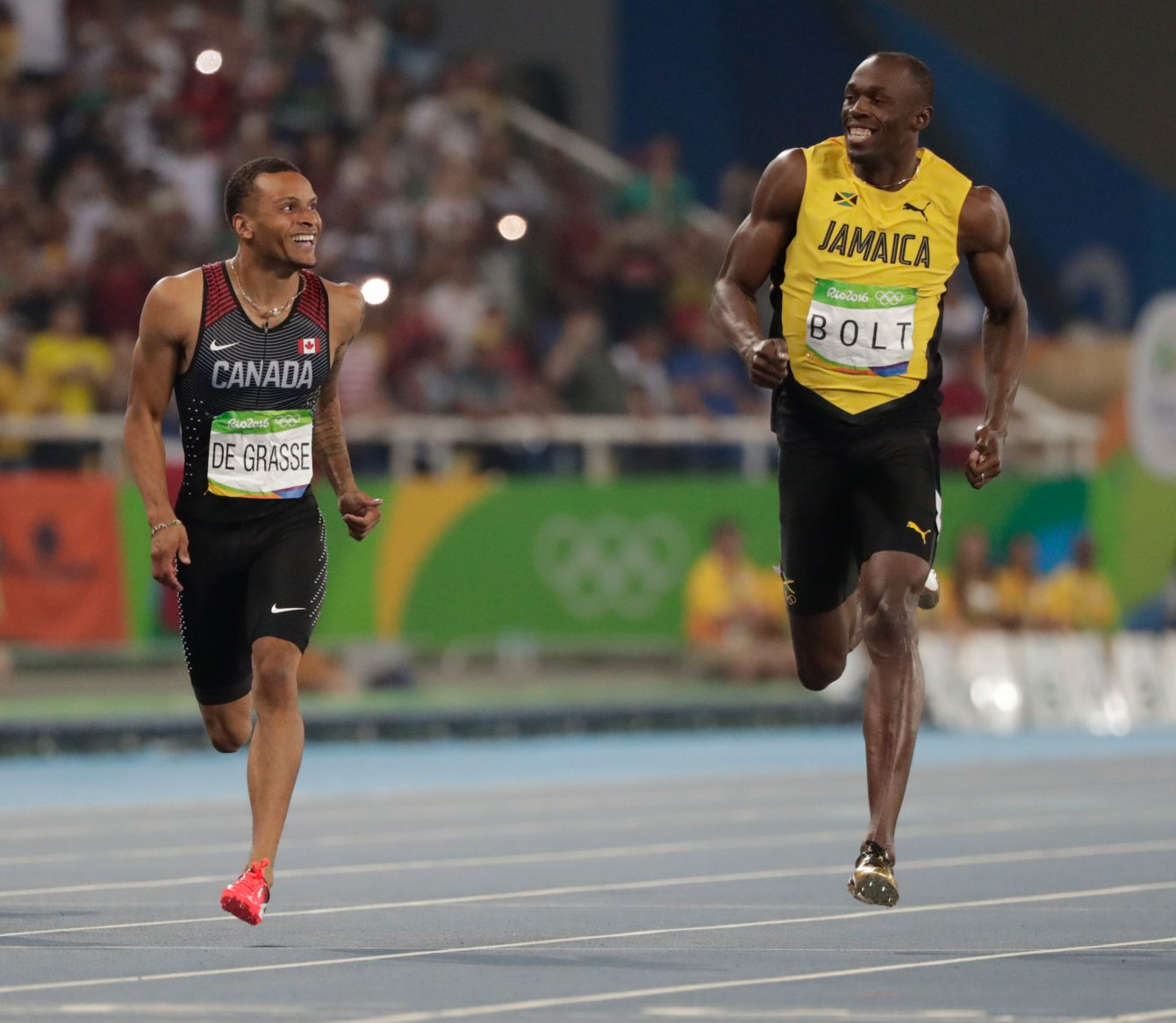 Andre De Grasse (left) and Usain Bolt share a laugh at the finish line in the semifinals of the Olympic 200m on August 17, 2016 in Rio de Janeiro.