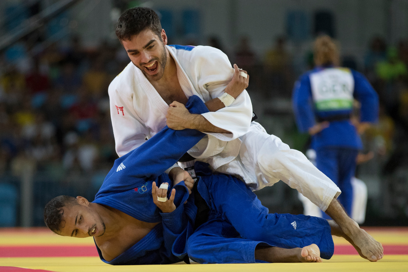 Canada's Antoine Bouchard takes on Imad Bassou of Morocco during Men's 66kg Judo, third-round action at the Olympic games in Rio de Janeiro, Brazil, Sunday, August 7, 2016. COC Photo by Jason Ransom