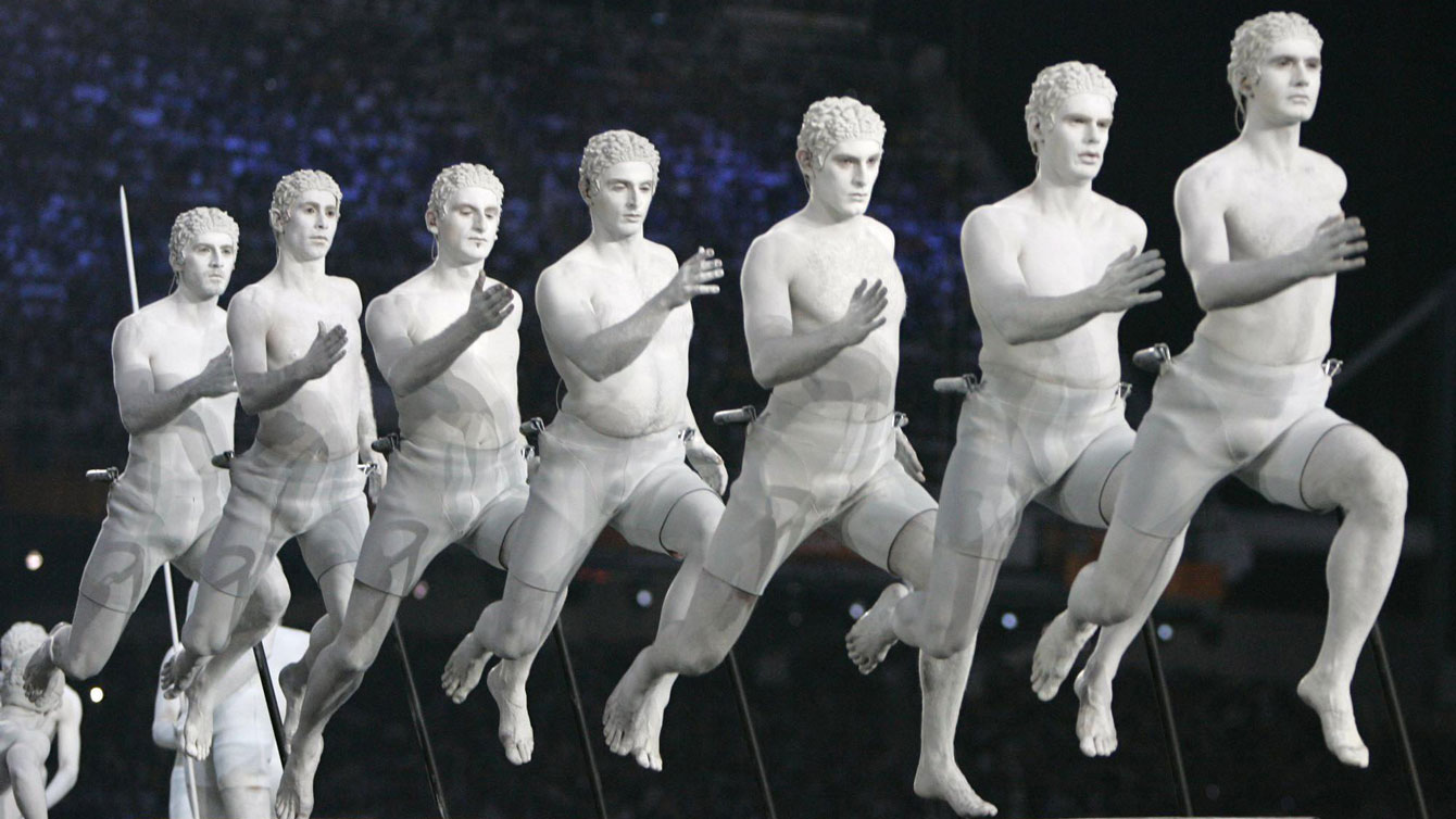 Performers representing figures from Greek mythology enter the stadium during the Opening Ceremony of the 2004 Olympic Games in Athens, Friday Aug. 13, 2004. (AP Photo/Laurent Rebours)