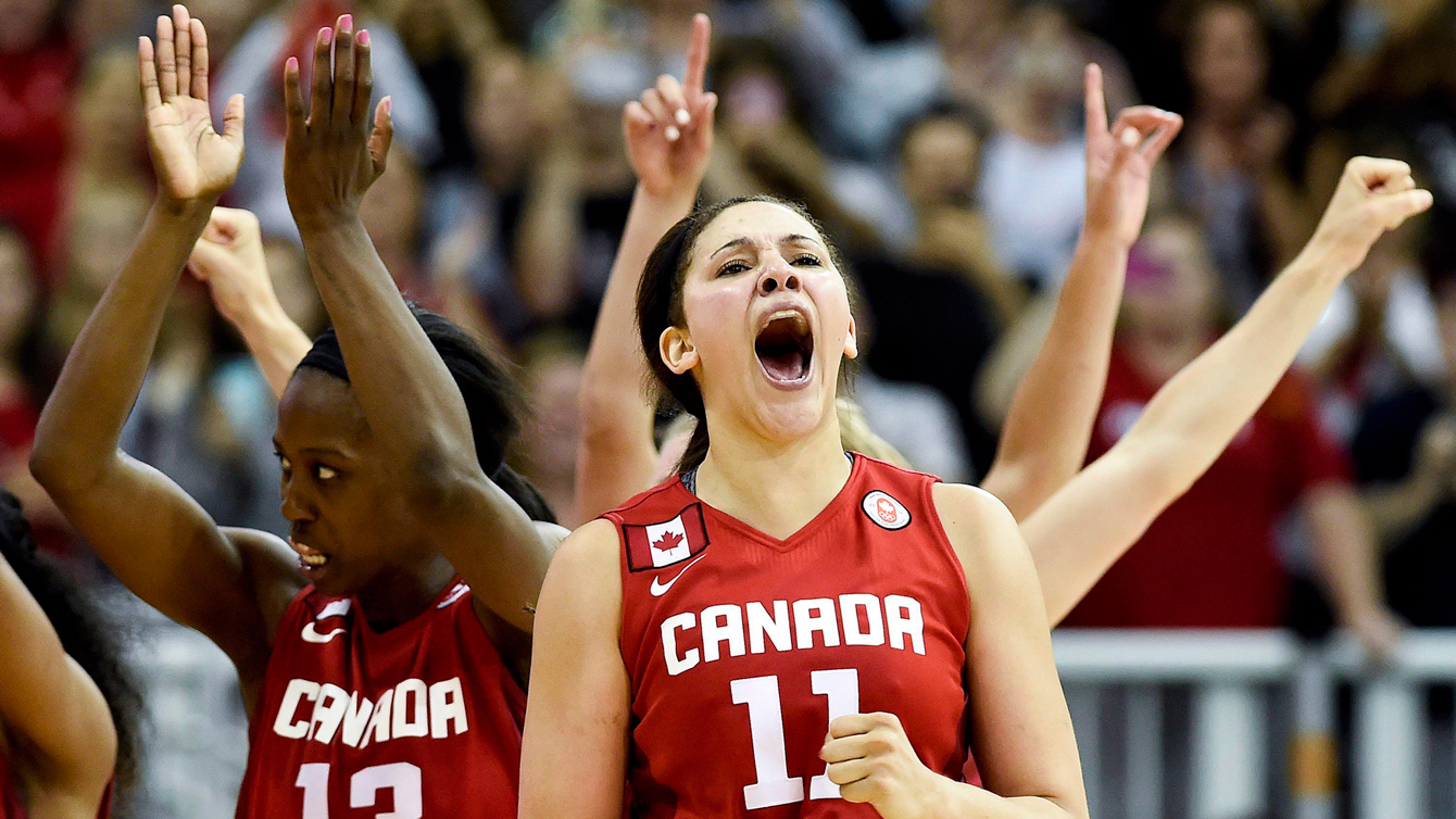 Canada forward Natalie Achonwa (11) reacts with her teammates after defeating the United States during second half to win the gold medal at the Pan American Games in Toronto on Monday, July 20, 2015. THE CANADIAN PRESS/Nathan Denette