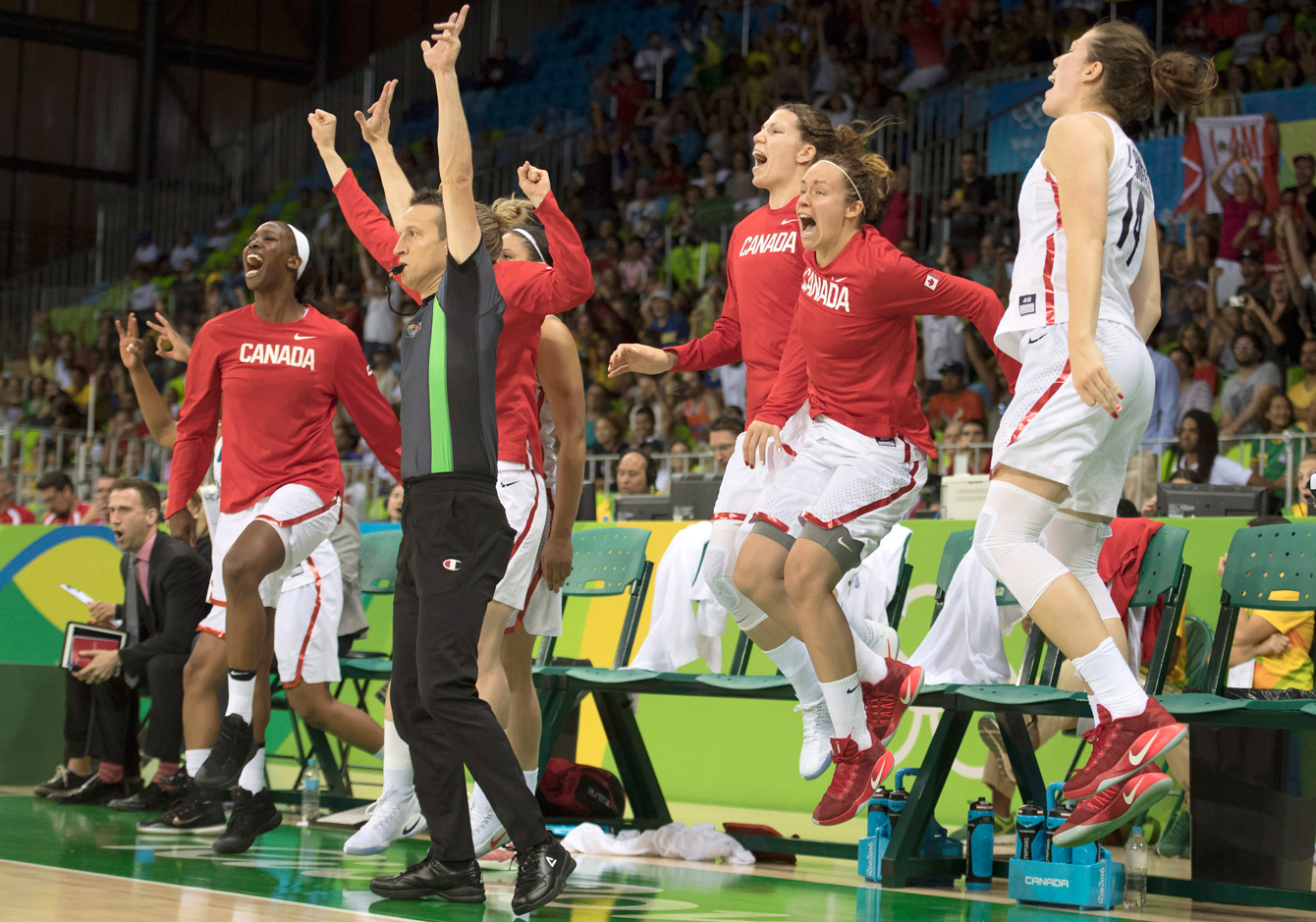 Canada's (left to right) Tamara Tatham, Michelle Plouffe, Shona Thorburn and Katherine Plouffe leap in the air as they celebrate the game-winning shot to defeat Serbia in their preliminary round basketball match at the 2016 Summer Olympics Monday August 8, 2016 in Rio de Janeiro, Brazil. THE CANADIAN PRESS/Frank Gunn