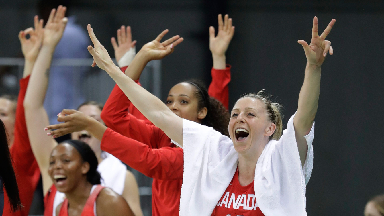 Canada forward Lizanne Murphy and teammates react after a three-point play during the second half of a women's basketball game against Chin at the Youth Center at the 2016 Summer Olympics in Rio de Janeiro, Brazil, Saturday, Aug. 6, 2016. (AP Photo/Carlos Osorio)