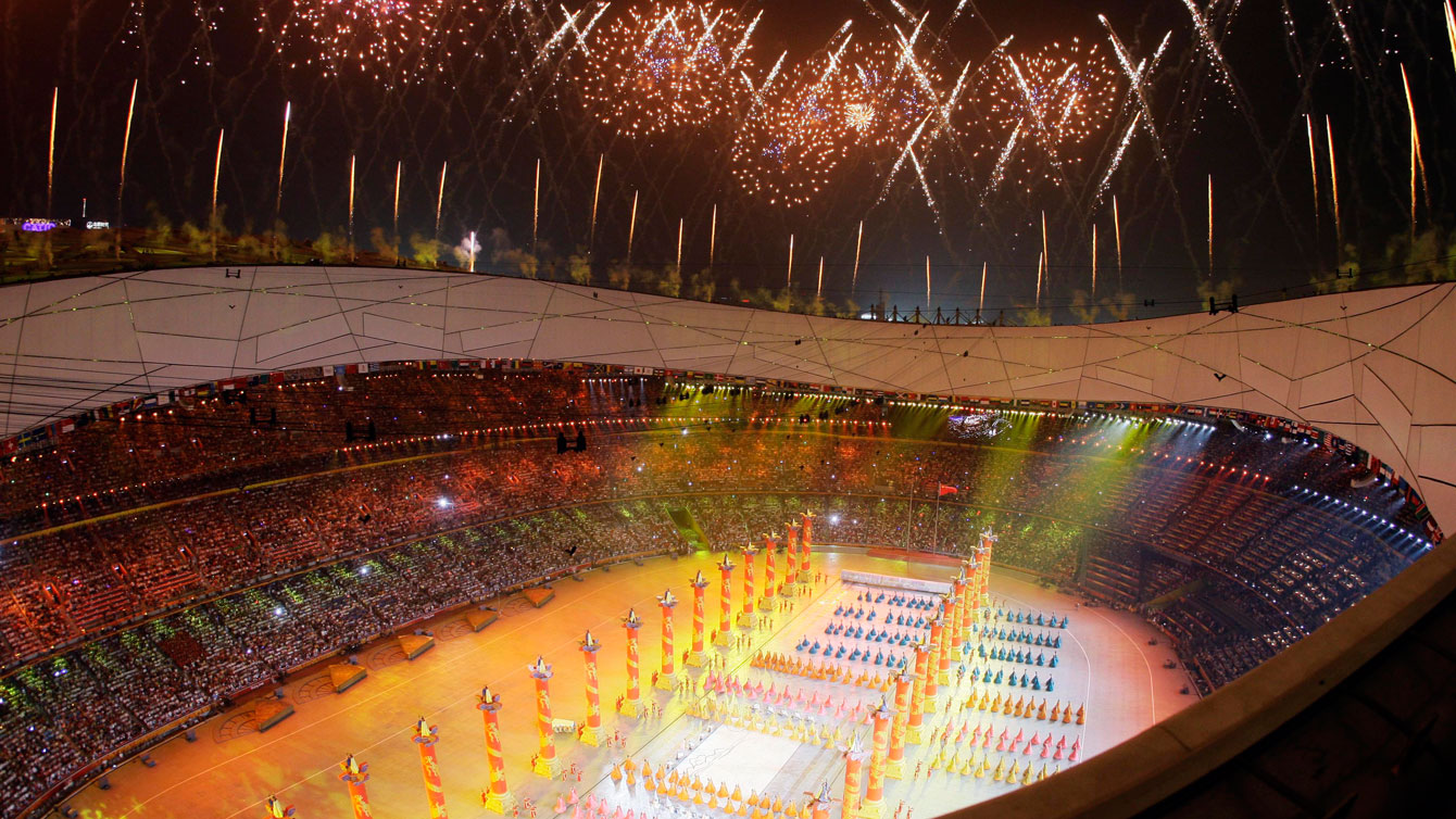 Fireworks explode over the National Stadium during opening ceremony of the 2008 Olympic Games in Beijing. (AP Photo/Julie Jacobson)