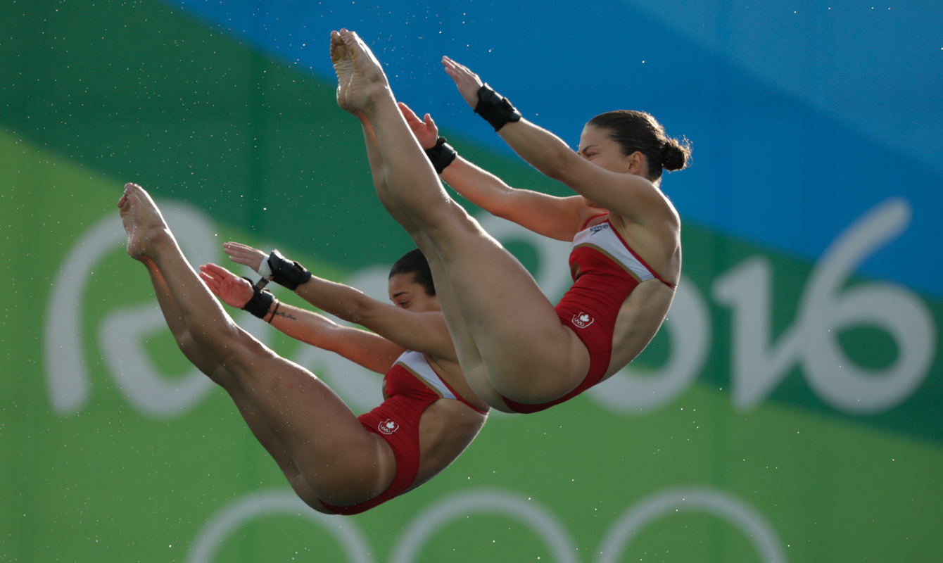 Canada's Meaghan Benfeito (left) and Roseline Filion perform in the women's synchronized 10-meter platform diving final at the 2016 Summer Olympics in Rio de Janeiro, Brazil, Tuesday, Aug. 9, 2016 (photo/ Jason Ransom)