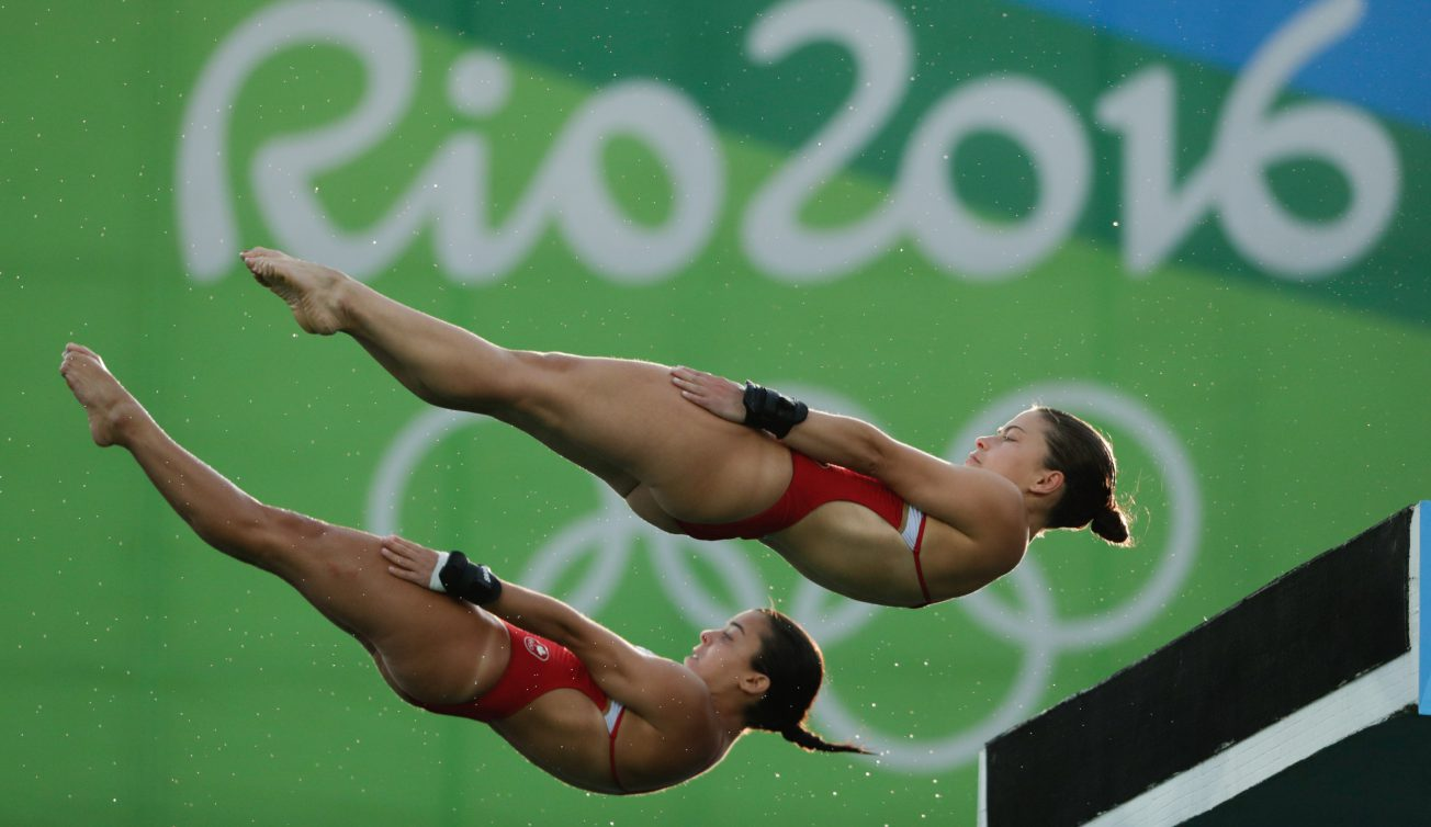Meaghan Benfeito and Roseline Fillion of Team Canada in the third round of the Women's Synchronised 10m Platform, on August 9, 2016 in Rio. COC Photo/Jason Ransom