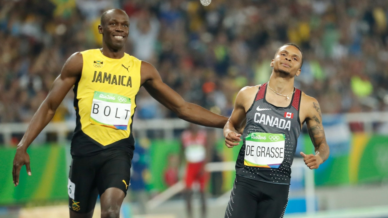 Usain Bolt and Andre De Grasse at the end of their 100m semifinal race on August 14, 2016.