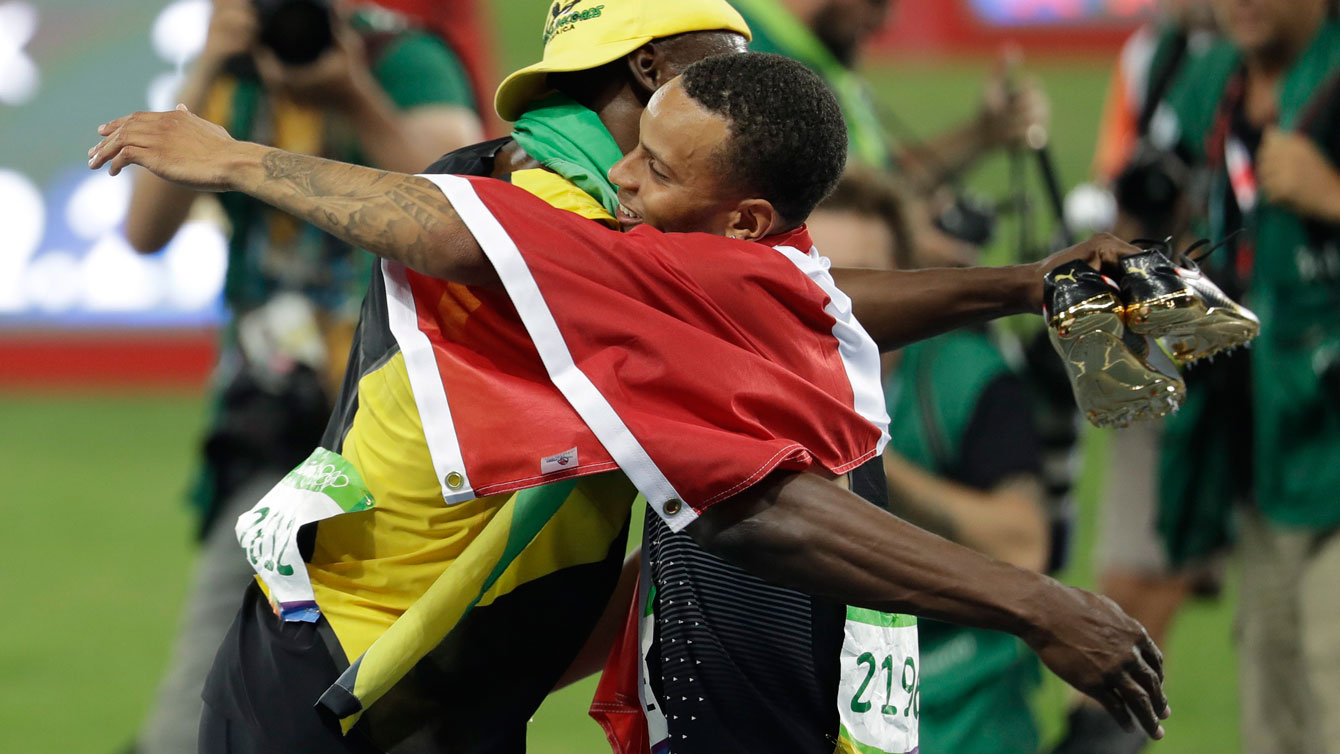 Usain Bolt (left) and Andre De Grasse hug after their respective gold and bronze medal finishes at the Olympic Games in Rio de Janeiro on August 14, 2016.
